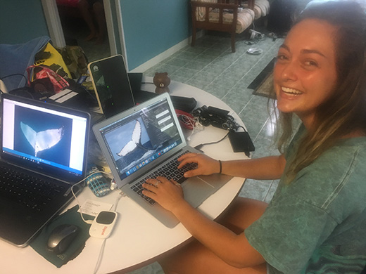Rolex scholar Melanie Brown editing photos for the Tongan Fluke Collective
